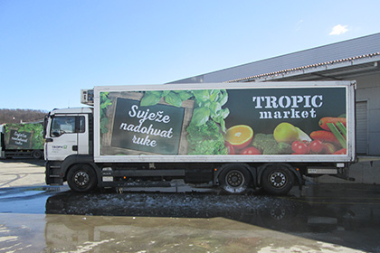 Image displaying tarpaulin on truck trailer